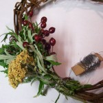 first 2 bunches of herbs on grapevine wreath base